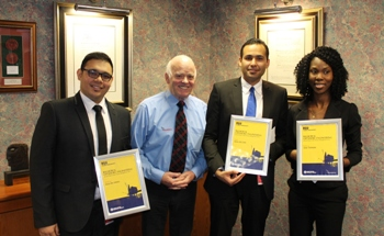Balmoral chairman and MD Jim Milne congratulates the winning RGU students on their achievements. Left to right: Hasan Bin Sohail, Jim Milne, Mutaz Abu-Zaid, Atiah Stephens.