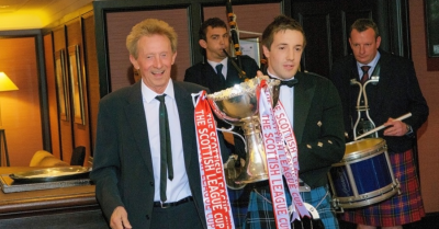 Denis Law and Streetsport Development Officer Tom Holt with the Scottish League Cup.
