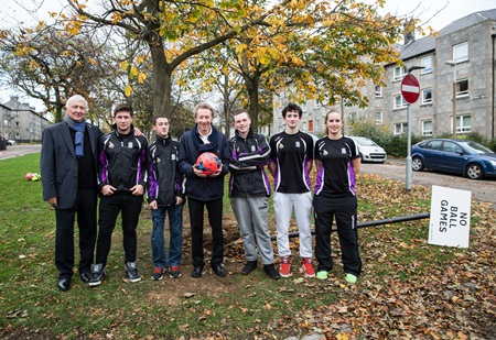 Denis Law (Centre) with the team from Denis Law Legacy Trust Streetsport.