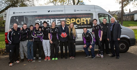 Denis Law (Centre) with the team from Denis Law Legacy Trust RGU Streetsport.