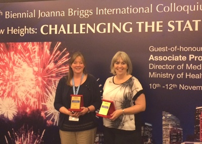 Dr Kay Cooper and Dr Lyndsay Alexander with their awards.