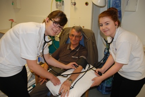 Banff Academy pupils Sascha Christie and Adele Milne tend to a volunteer patient at RGU's Nursing Summer School.