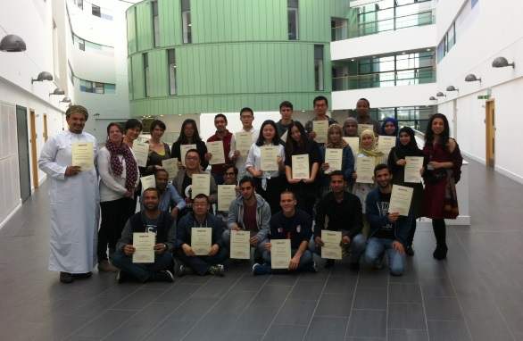 Pre-Sessional English students posing with their certificates