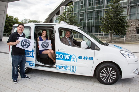 From left to right - RGU Student President Edward Pollock, Aberdeen University Student President Genna Clarke, and General Manager of Rainbow City Taxis Gordon McKay.