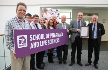Professor Donald Cairns, Head of the School of Pharmacy & Life Sciences, received the plaque from Andrew Scott (right), the Corporate & Government Sales Manager of the Royal Society of Chemistry.