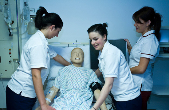 Radiography students with 'Sim Man'