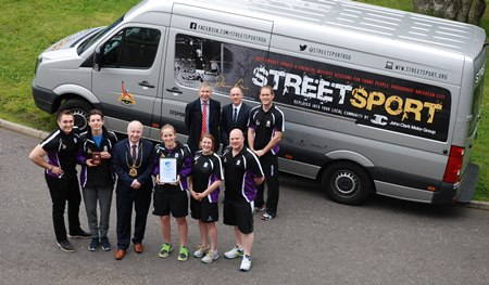 Lord Provost Councillor George Adam presented the ACVO award to the Denis Law Streetsport team recently.