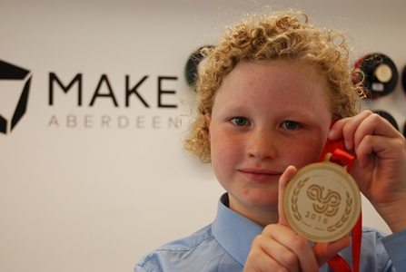 P6 Mile End School pupil Tom Robertson (10) unveiled his winning Aberdeen Youth Games medal design at Make Aberdeen.