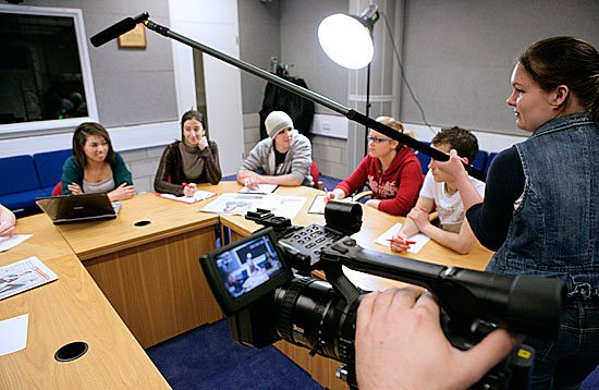 Students using media equipment